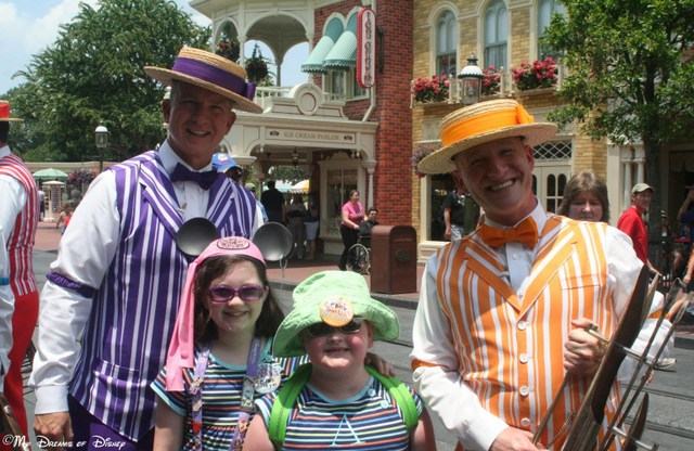 On Main Street, U.S.A., Sophie and Anna Jane get a photo with two of the Dapper Dans!