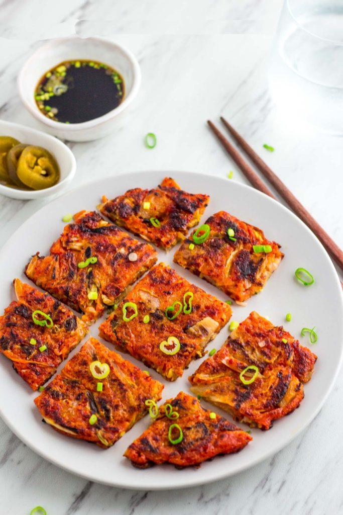 Vegan Korean kimchi pancake, dipping sauce and jalapeño