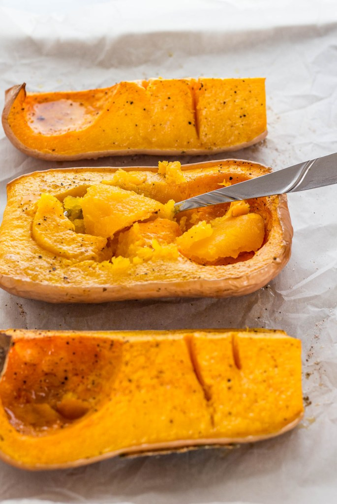 After taking the roasted butternut squash out of the oven. In process of scooping the meat out with the spoon.