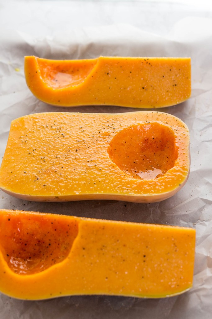 Butternut squash before roasting in the oven, seasoned with salt and pepper
