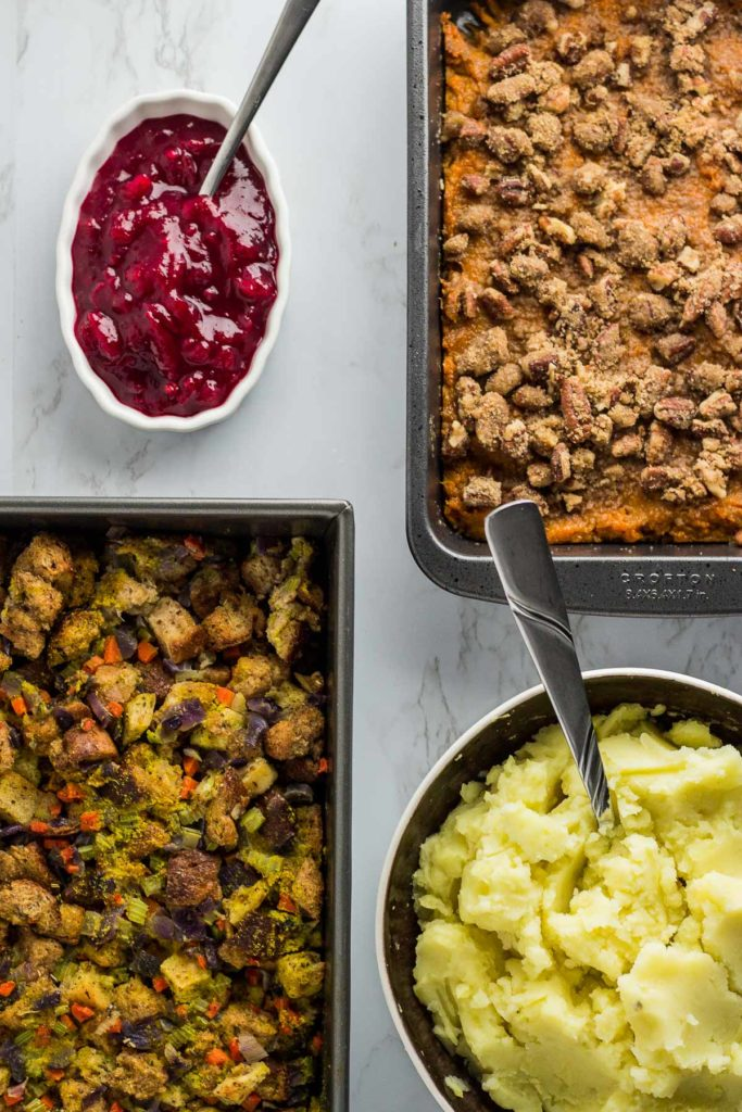Cranberry apple sauce, sweet potato casserole, mashed garlic potato, and stuffing
