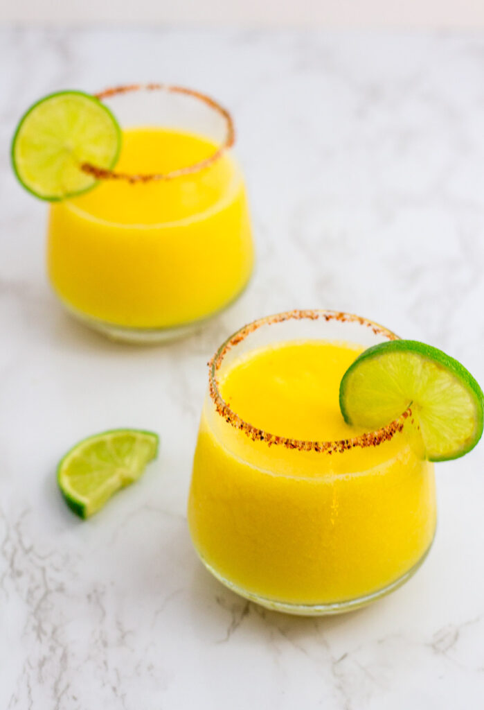 frozen margarita with lime slice as a garnish