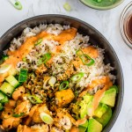 overhead shot of vegan sushi bowl with rice, vegan fish filets, avocado, cucumber