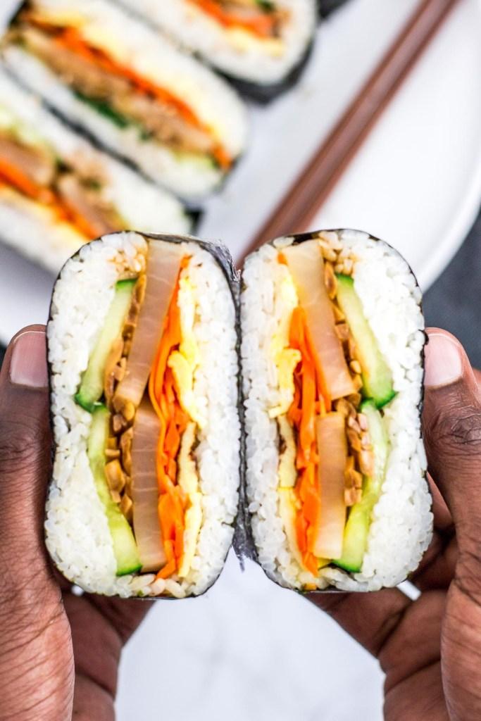 vegetarian kimbap onigirazu cut in half to show the fillings