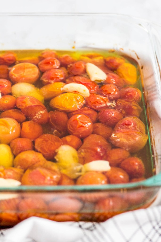 slow roasted cherry tomatoes and garlic in olive oil