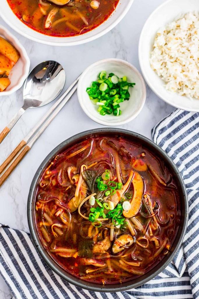 vegan version of mushroom yukgaejang with rice and kimchi on the side
