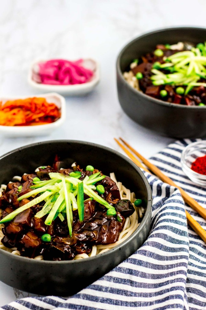 two bowls of vegan Korean black bean noodles