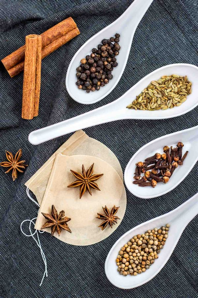 Warming spices - cinnamon, black pepper corns, fennel seeds, cloves, coriander seeds, and star anise