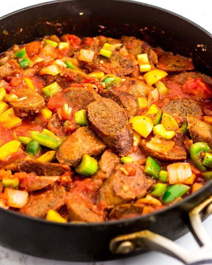 cooked vegan sausage added to the creole sauce