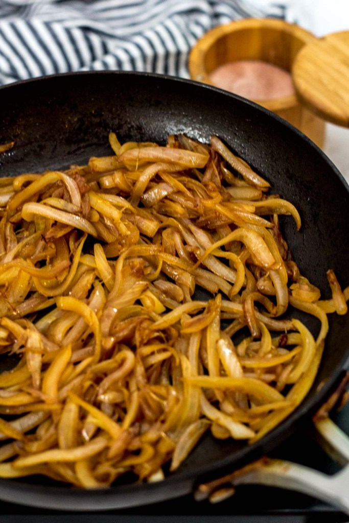 caramelized onion being cooked in a pan
