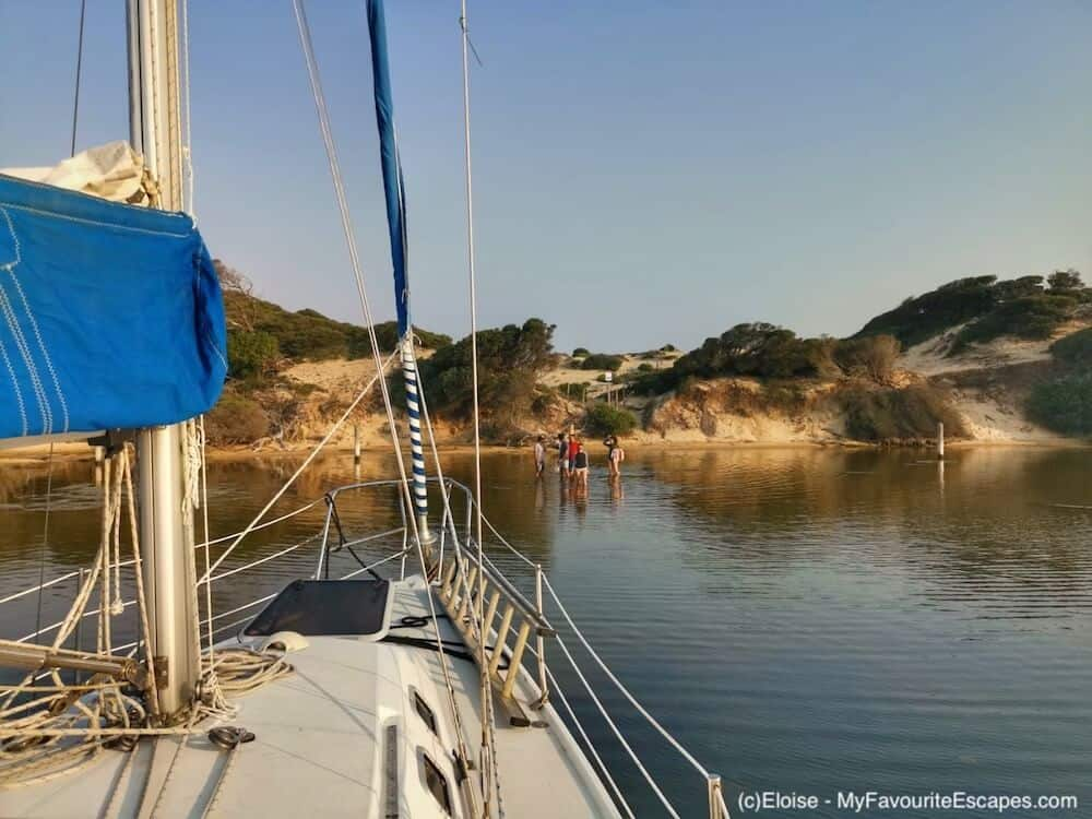 Sailing boat beach Gippsland Lakes