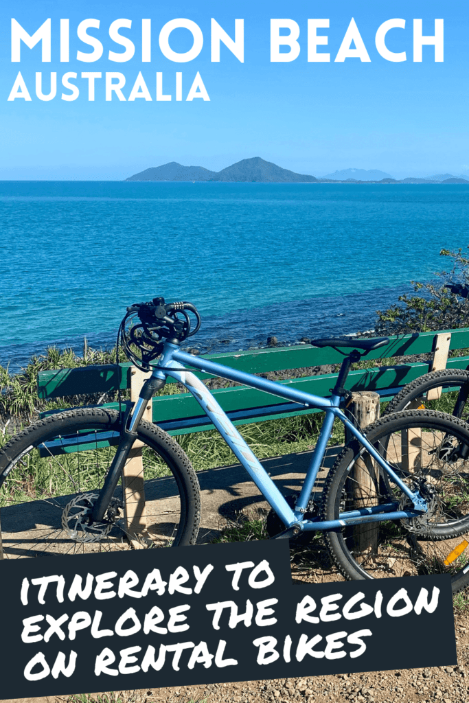 """Bike parked in front of a bench with Dunk Island in the background with the text """"Mission Beach, Itinerary to explore the region on rental bikes"""""""