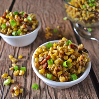 Sweet Corn & Bacon Salad from Alarm Clock Wars. There is only so much corn on the cob you can eat without getting bored, and it's only available during the summer! This Sweet Corn and Bacon Salad recipe is an easy way to enjoy sweet corn, any time of the year!
