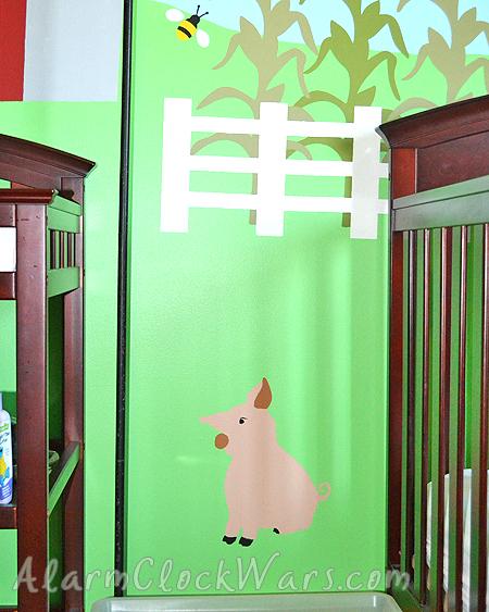 a pig in a farm-themed nursery