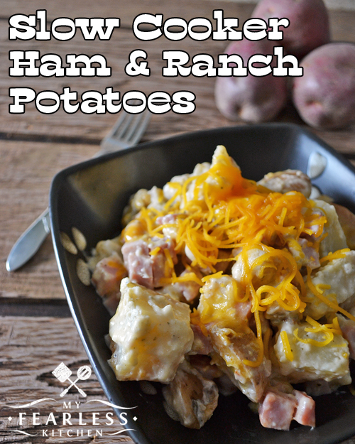 slow cooker ham and ranch potatoes in a brown bowl on a wood background