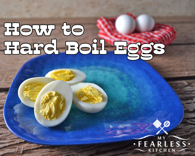 sliced hard boiled eggs on a blue plate