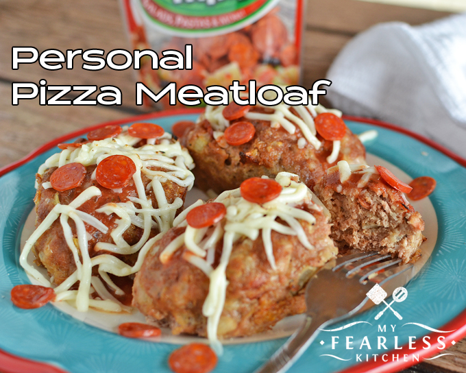 three personal-sized meatloaves topped with mini pepperoni and shredded mozzarella cheese