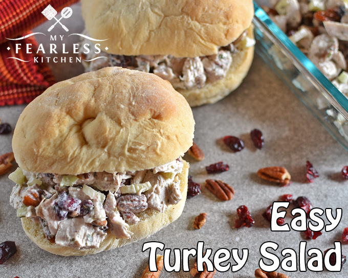 two turkey salad sandwiches on homemade buns