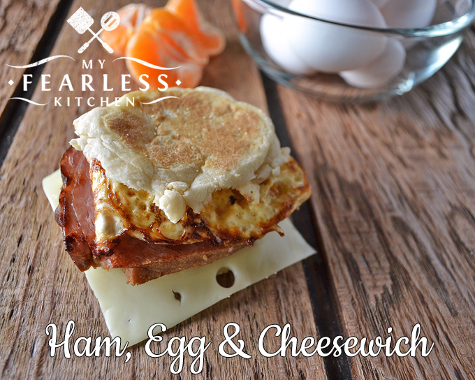ham, egg, and swiss cheese breakfast sandwich on an english muffin