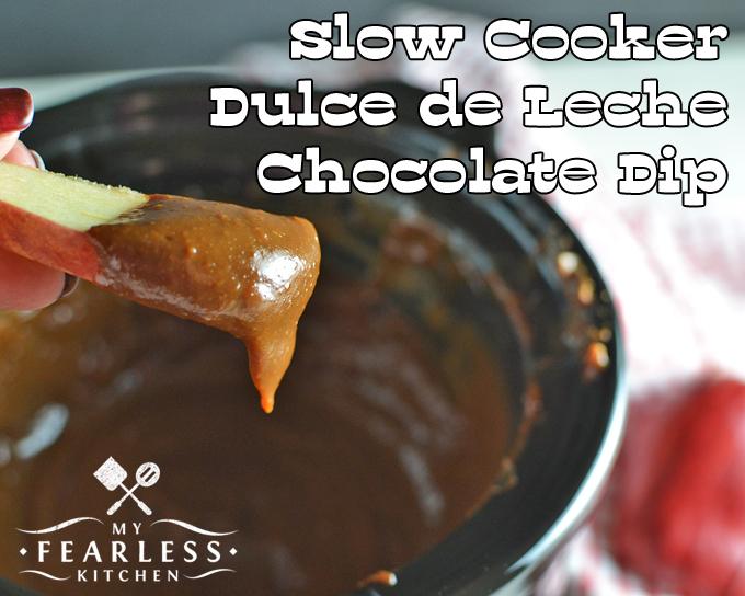 an apple slice with dulce de leche chocolate dip