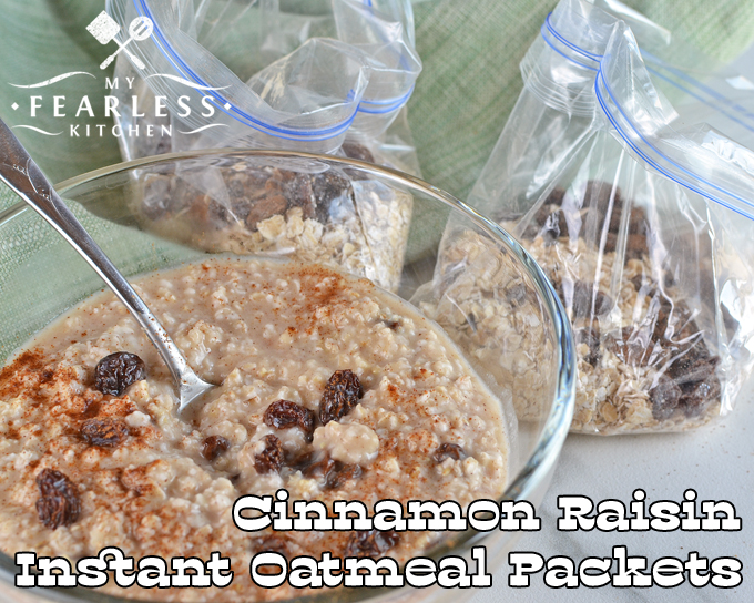 a bowl of cinnamon raisin oatmeal with two packets of homemade cinnamon raisin instant oatmeal