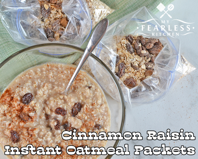 bowl of cinnamon raisin oatmeal with two homemade packets of instant cinnamon raisin oatmeal