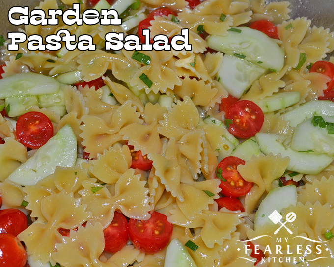pasta salad with bow tie pasta, tomatoes, and cucumbers