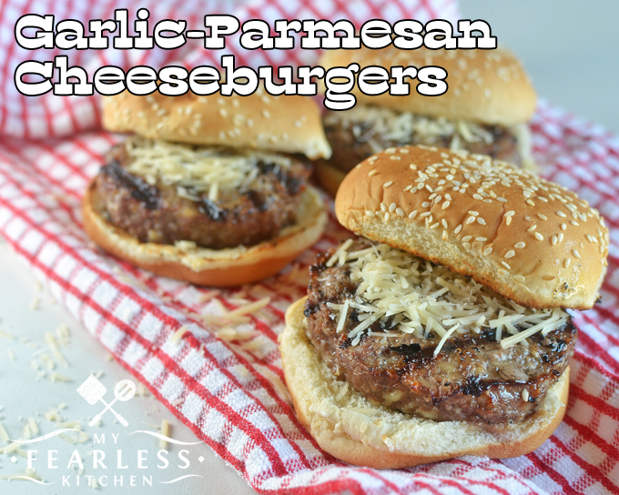 garlic-parmesan cheeseburgers topped with extra shredded parmesan cheese