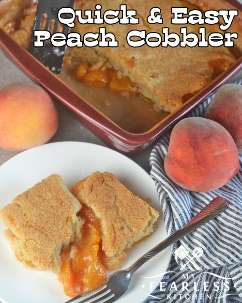 overhead image of peach cobbler on a white plate with fresh peaches