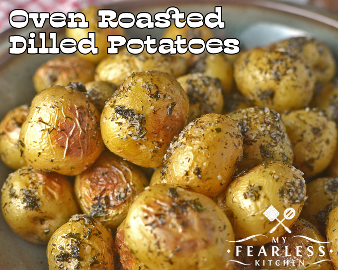 close-up view of little potatoes oven roasted with dill and salt