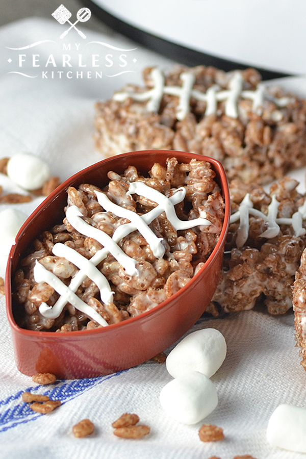 Slow Cooker Chocolate Football Rice Krispie Treats from My Fearless Kitchen. These adorable Chocolate Football Rice Krispie Treats are the perfect snack for your next tailgate party. Skip the stove and make them in your slow cooker! #ricekrispie #football #slowcooker #tailgate #superbowl