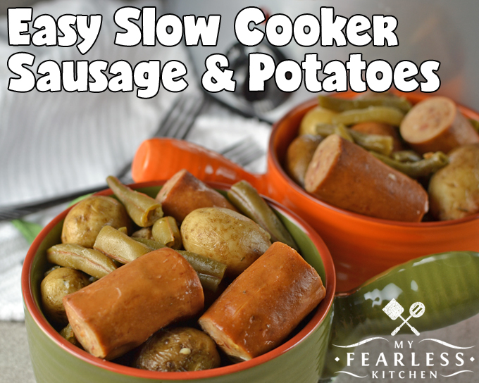 sausage with potatoes and green beans in large soup bowls