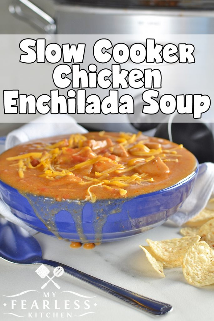 Slow Cooker Chicken Enchilada Soup from My Fearless Kitchen. If you love cheesy enchiladas, you'll love this Slow Cooker Chicken Enchilada Soup! All the flavor of traditional enchiladas is in this easy crockpot recipe. #slowcooker #crockpot #soup #enchilada