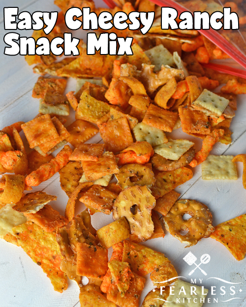 cheese and ranch flavored snack mix with crackers, chips, and pretzels on a white background