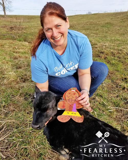 Marybeth with a newborn black angus calf