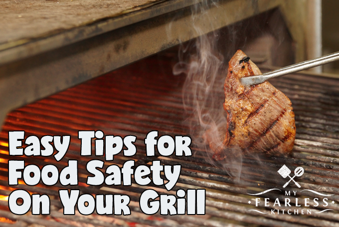 taking a cooked steak off a grill