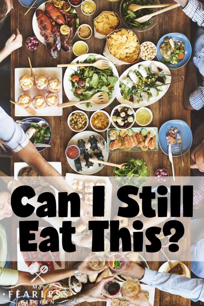 different types of food being shared around a long wooden table