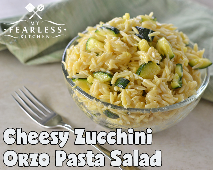 orzo pasta salad with zucchini in a glass bowl