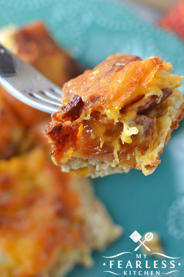 Cheesy Bacon Breakfast Casserole from My Fearless Kitchen. This protein-packed Cheesy Bacon Breakfast Casserole will get your sleepy heads out of bed and ready for breakfast in a hurry! Prep it ahead of time, and it's perfect for your busy mornings. #breakfastrecipes #easyrecipes #casserolerecipes #baconrecipes