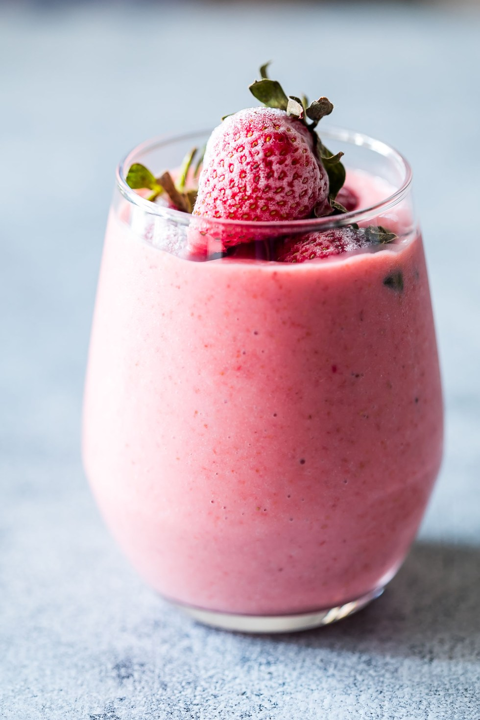 Frozen strawberry greek yogurt smoothie is thick, creamy and utterly delicious! This strawberry smoothie with yogurt is the perfect protein and nutrient rich 10 minute breakfast for busy days.