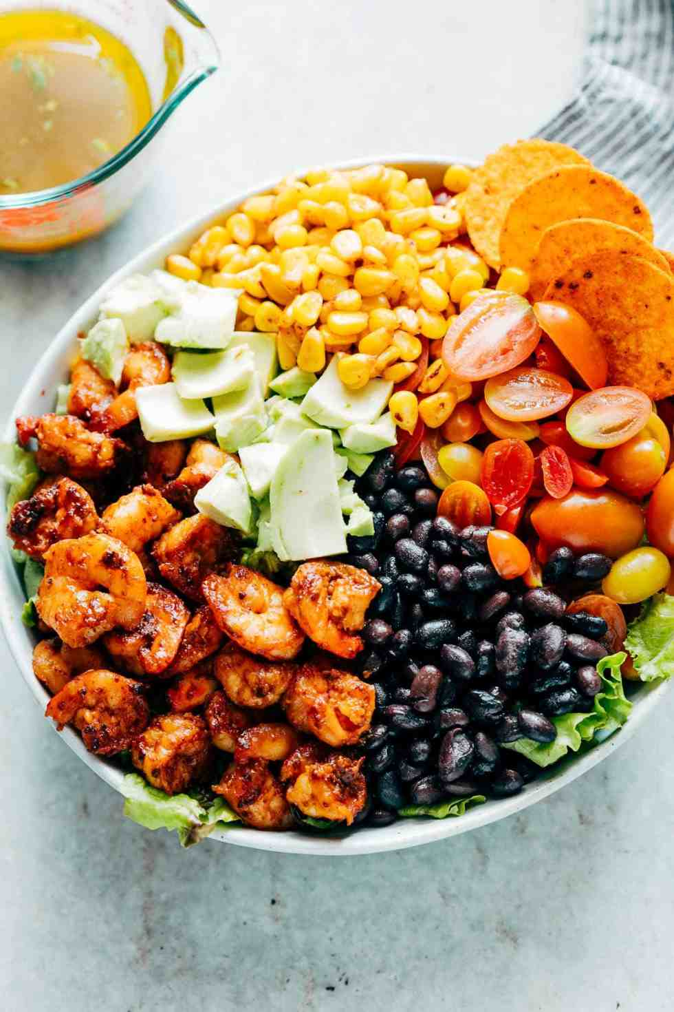 Mexican Prawn Avocado Taco Salad is a delicious, hearty salad that has all the flavours of your favourite mexican taco, but healthier. Loaded with lettuce, black beans, avocado, cherry tomatoes and a delicious cilantro lime dressing, it's perfect when you want salad for dinner.