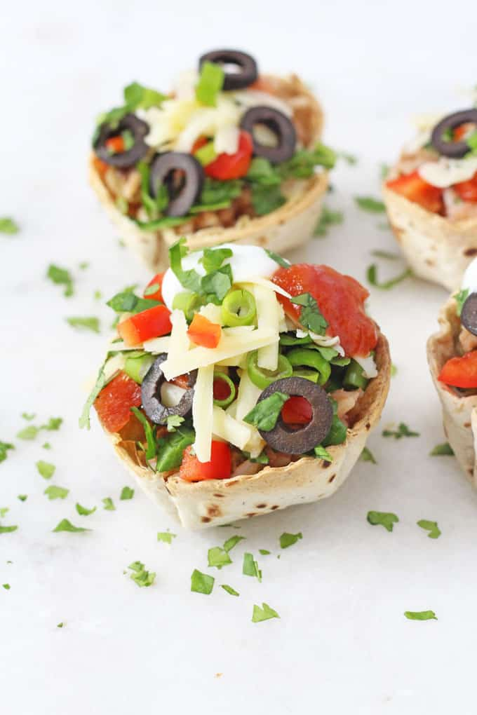 Use up leftover chilli and make these quick and easy Taco Cups filled with green and black olives, cheese and red peppers | My Fussy Eater blog