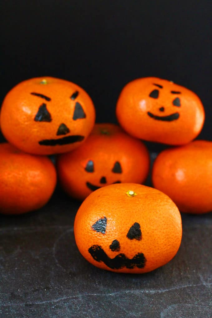 these clementine pumpkins are a fun and healthy halloween snacks for kids my fussy