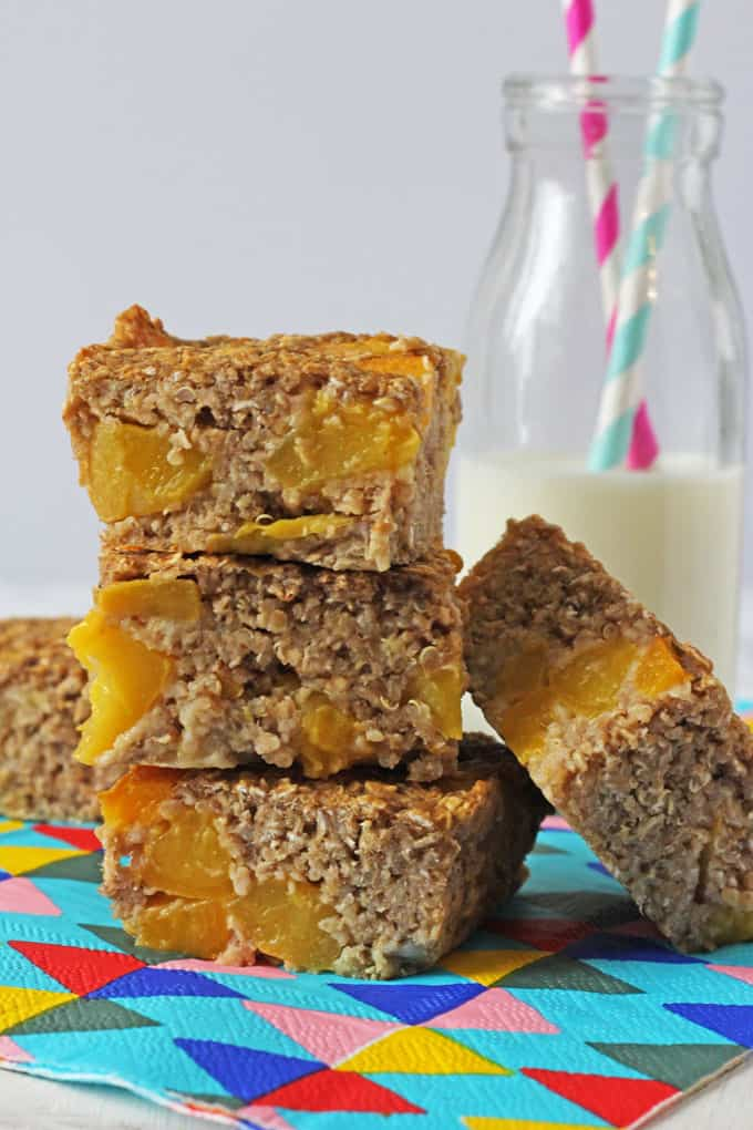 Delicious and so easy to make, these Quinoa Breakfast Bars are made with canned peach slices. Ideal for grab-and-go breakfast on busy mornings!