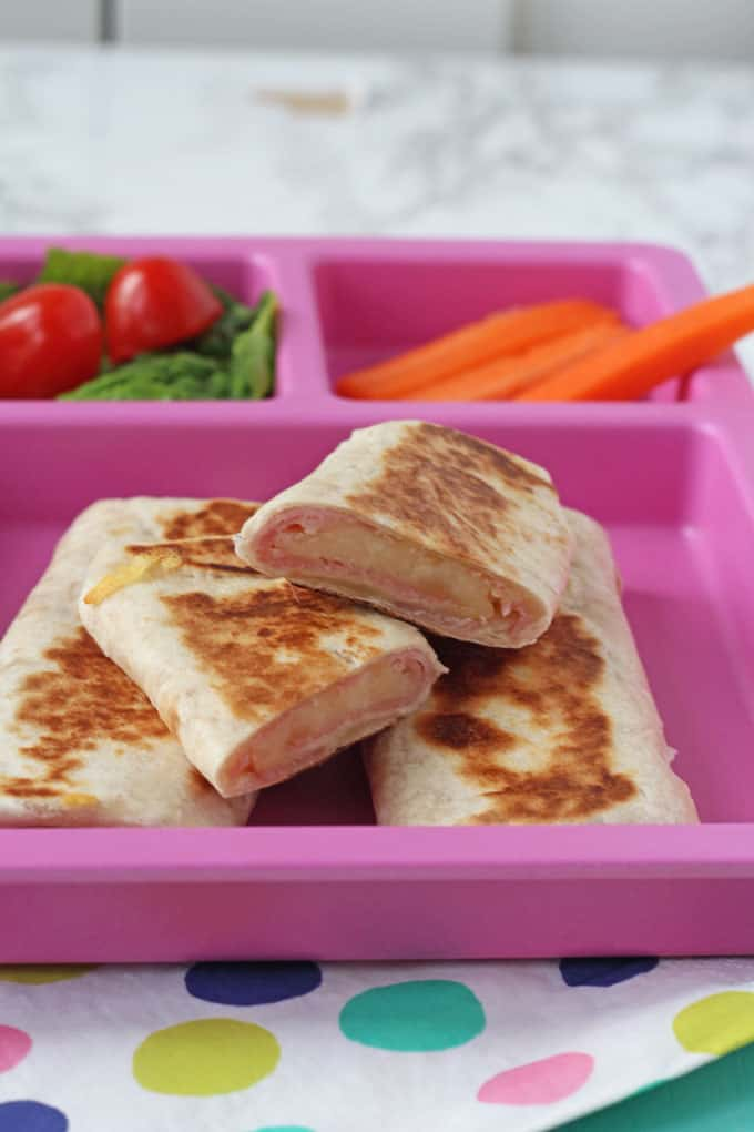 These Ham & Cheese Wraps and folded up like mini burritos and dry fried quickly to make them melting on the inside but crispy on the outside. So delicious and perfect for lunch at home or a packed lunch at school!
