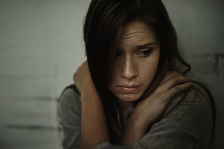 young woman suffering from dangers of untreated schizophrenia