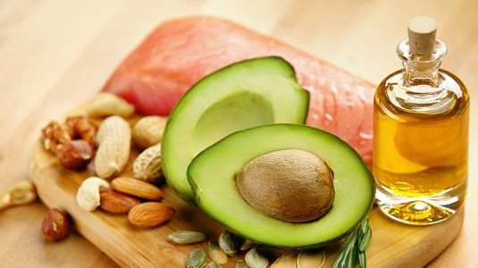 avocado, nuts, salmon, and oil to represent sources of healthy fat