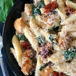Chicken alfredo pasta with sun-dried tomatoes and spinach