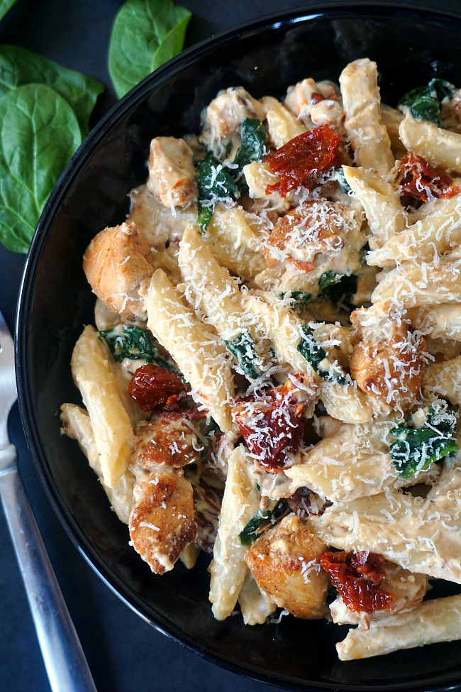 Chicken alfredo penne pasta with sun-dried tomatoes and spinach
