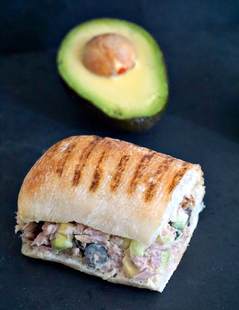 Simple tuna salad sandwich recipe wih avocados, black olives and cucumber, healthy, filling and so delicious.